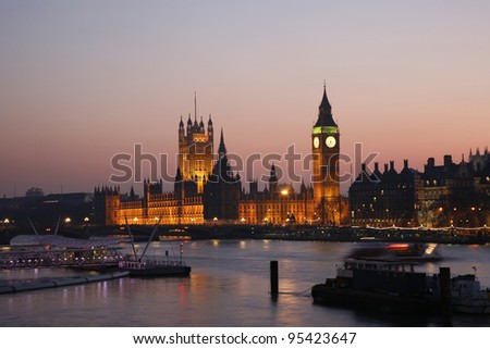 Westminster Palace, Big Ben and Victoria Tower, seen from Hungerford Bridge at Dusk