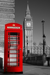 Westminster phone box in color with the Palace of Westminster in black and white in the background.