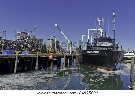 WESTPORT, WA - AUGUST 24: A fishing trawler docks in the Port of Grays Harbor, Washington State on August 24, 2010 in Wesport, WA. It is the number one seafood landing point in Washington State.