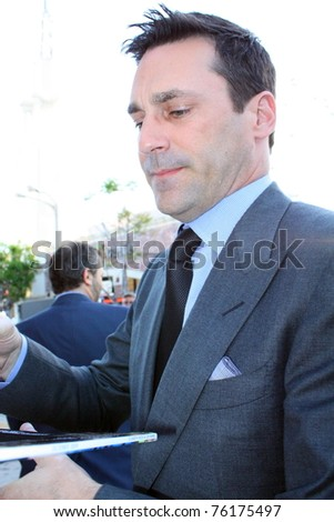 WESTWOOD, CA - APRIL 28: Actor Jon Hamm signing autographs at the premiere of the movie Bridesmaids at the Village Theatre on April 28, 2011 in Westwood, CA.