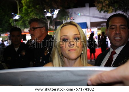 WESTWOOD CA - DECEMBER 13: Reese Witherspoon signing autographs at  the premiere of the movie How Do you Know at the Village and Bruin Theatres December 13, 2010 in Westwood, CA. - stock photo