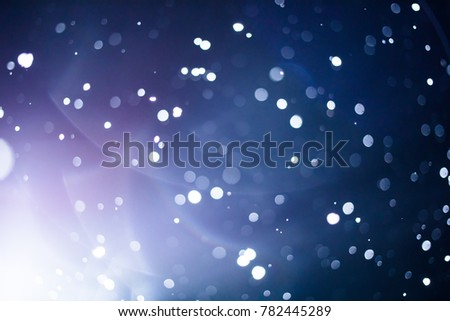 Wet and Smugy Lens Flare and Blurry Snowflakes or Filter Background during Snowstorm at Night Zdjęcia stock ©