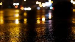 Wet asphalt, night view, neon reflection on the concrete floor. Night empty stage. Dark abstract background, dark street. Night city after rain, wet surface. Blurred background.