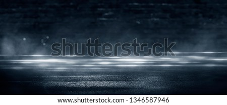 Wet asphalt, reflection of neon lights, a searchlight, smoke. Abstract light in a dark empty street with smoke, smog. Dark background scene of empty street, night view, night city. #1346587946