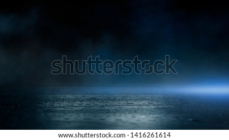 Wet asphalt, reflection of neon lights, a searchlight, smoke. Abstract light in a dark empty street with smoke, smog. Dark background scene of empty street, night view, night city.