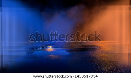 Wet asphalt, reflection of neon lights, a searchlight, smoke. Abstract light in a dark empty street with smoke, smog. Dark background scene of empty street, night view, night city. #1458517934
