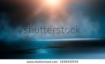 Wet asphalt, reflection of neon lights, a searchlight, smoke. Abstract light in a dark empty street with smoke, smog. Dark background scene of empty street, night view