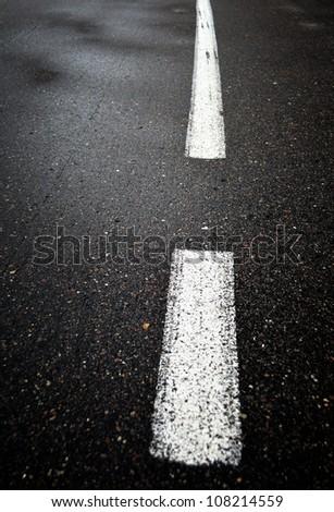 Wet asphalt road close up