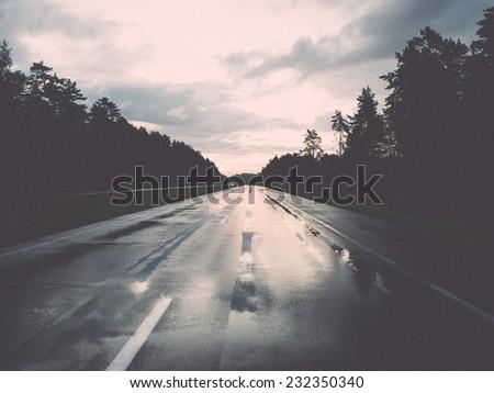 wet asphalt road with sun...