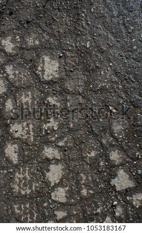 Wet asphalt. Wet asphalt background.  Asphalt texture and background. Scabrous asphalt.       #1053183167