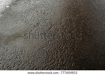 Wet asphalt. Wet asphalt background. Wet asphalt texture. Grunge pavement. #777604852