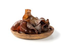Wet black fungus, tree ear or wood ear mushroom isolated on white background side view. Soaked dry auricularia polytricha also known as cloud ear, black mushroom, jelly fungus or cloud ear fungus