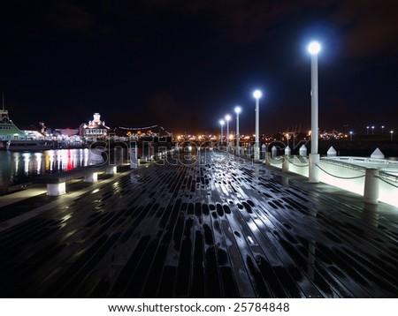 Wet boards on an empty ocean front pier.