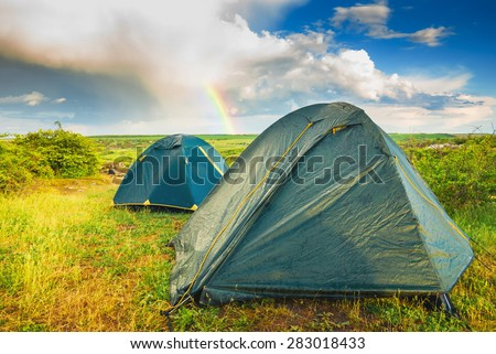Wet camping tents after the rain in a valley of Ukrainian National park