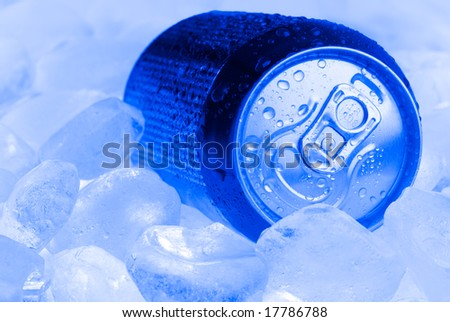 Wet can on the ice cubes, blue toning.