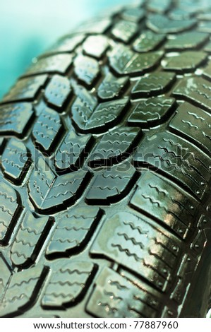 Wet car tire texture in green and blue colors
