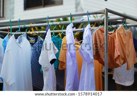 Wet clothes hang on the clothes line