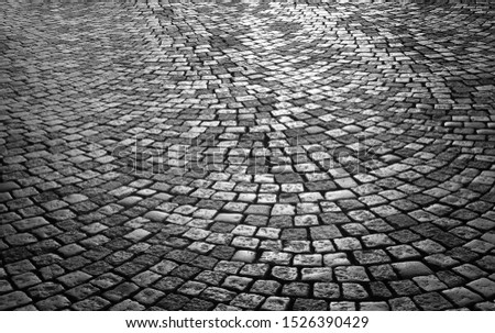 Wet cobbled paving at night