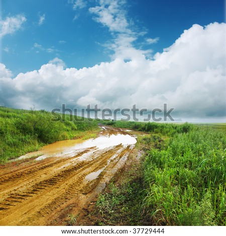 Wet dirty road after strong rain
