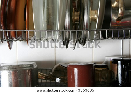 Wet dishes drying on the metal plate rack