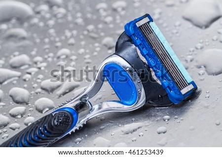 wet disposable razor isolated.closeup