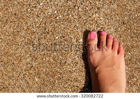 Wet female feet by water on sand #320082722