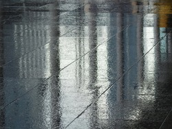wet floor after rain with water reflection in street