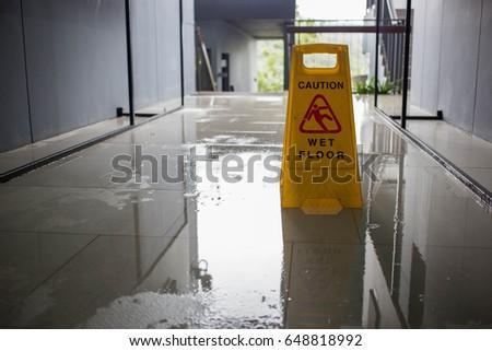Wet floor caution sign. #648818992