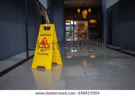 Wet floor caution sign. #648819004