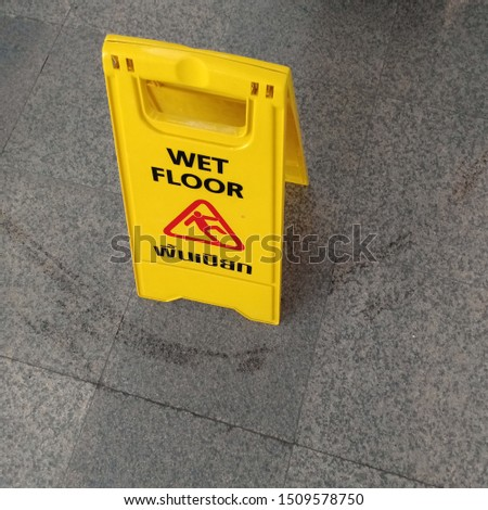 Wet Floor Signs, Prevent accidents from wet floors and slippery areas, English and Thai language.