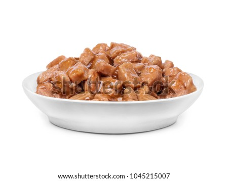 Wet food for dogs and cats in a bowl close up