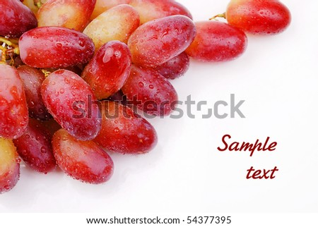 wet fresh red grapes with place for text isolated on white