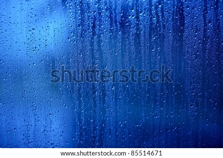 Wet Glass. Water Drops on the Blue Glass - Background, Texture