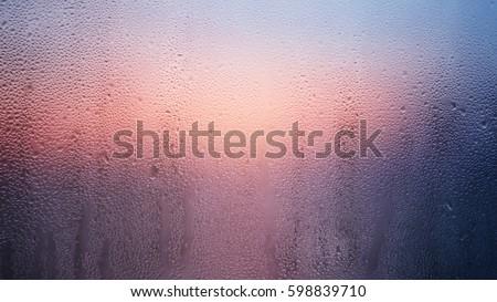 Wet glass 1. Wet glass in a summer dawn. #598839710