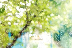 wet home window with raindrops after summer rain