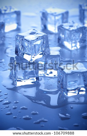 wet ice cubes on blue background
