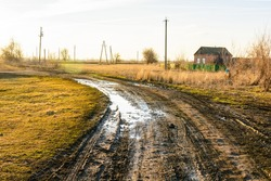 Wet muddy country road