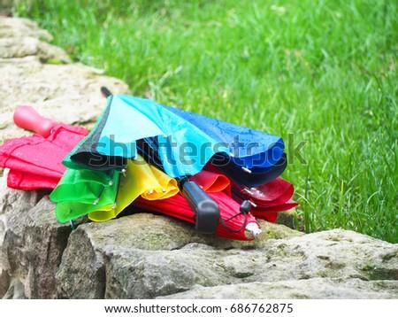 Wet multicolored umbrellas  #686762875
