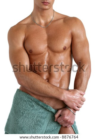 Wet muscular sexy man wrapped in the towel isolated on white