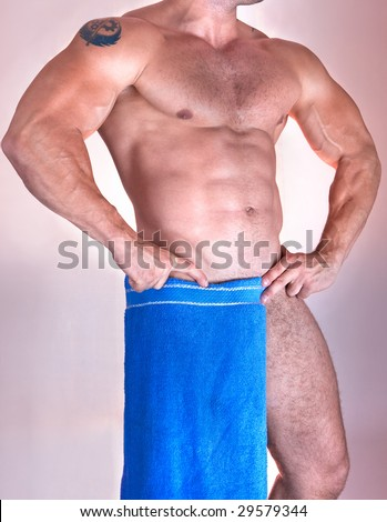 Wet muscular torso wrapped in the towel isolated on pink - stock photo