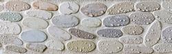 Wet pebbles mosaic tiles design in shower cabin of modern bathroom.