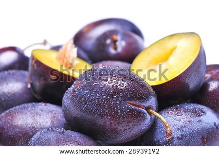Wet plums on white background