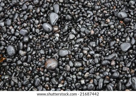 Wet sea pebbles on a beach close up