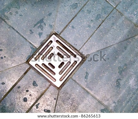 Wet shower drain - stock photo