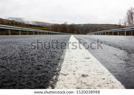 wet slippery road in bad weather