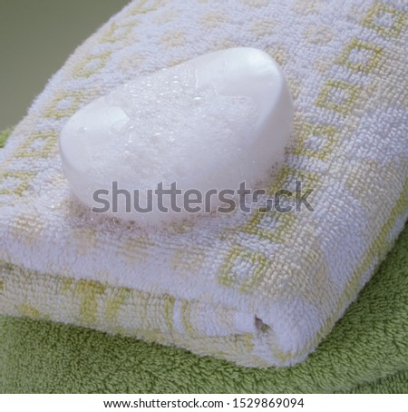 wet soap bar on nice towels