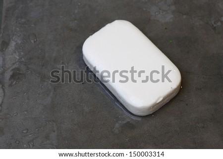 Wet Soap with no bubble on Concrete Floor