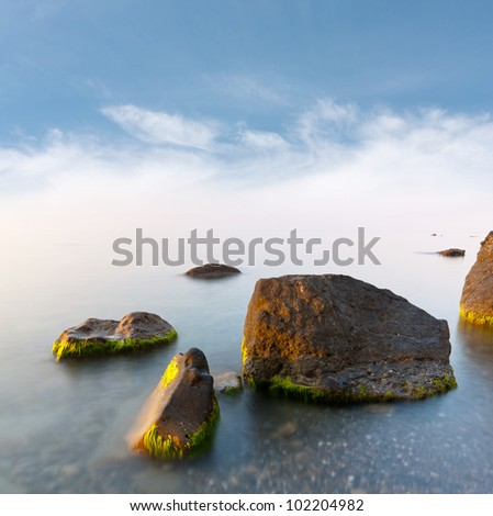 wet stones in early morning on sea