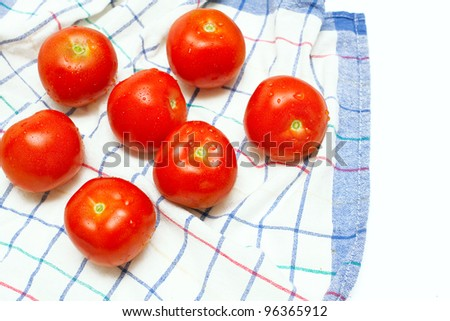 wet tomatoes on kitchen towel and empty space for your text