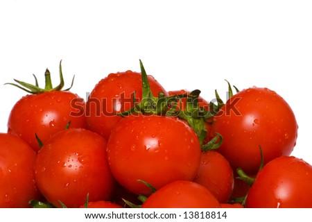 Wet whole tomatos arranged isolated on white